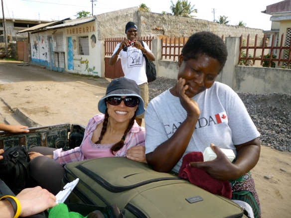 Jane, Violetta (our House Keeper, a common job in Mozambique) and Dionisio in the background (our chief man about town)